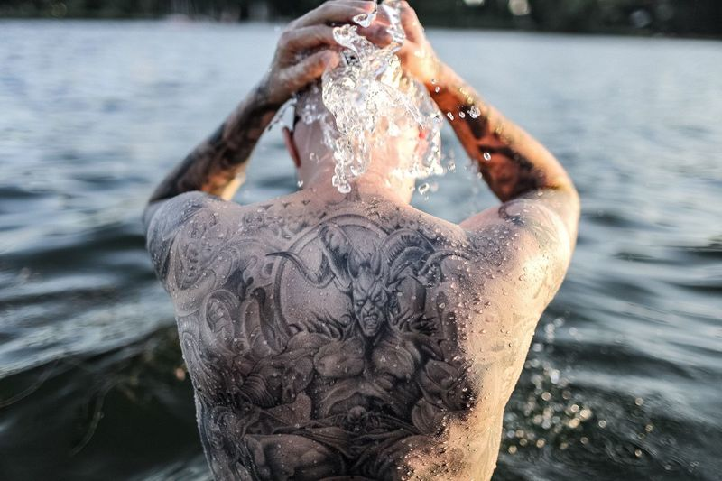 Water Focus On Foreground Wet Lake Waterfront Day Drop Motion Real People Outdoors One Person Close-up Nature Human Hand People Tattoo Tattoos Devil