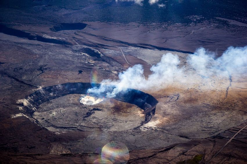 Kilauea Crater Erupting Eruption Vog Kilauea Volcano Kilauea Volcano Land One Person Day Nature Motion Lifestyles Outdoors High Angle View Beauty In Nature Power In Nature