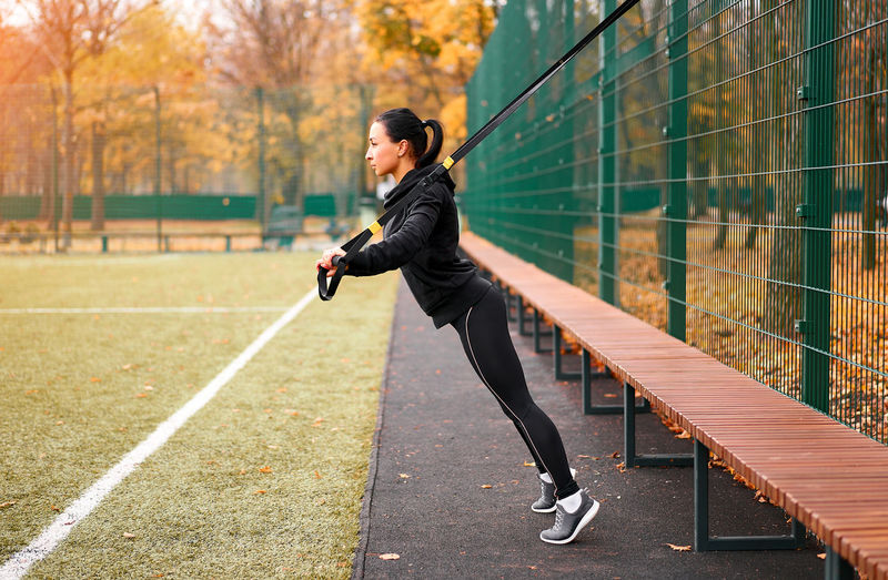 Full length side view of woman exercising