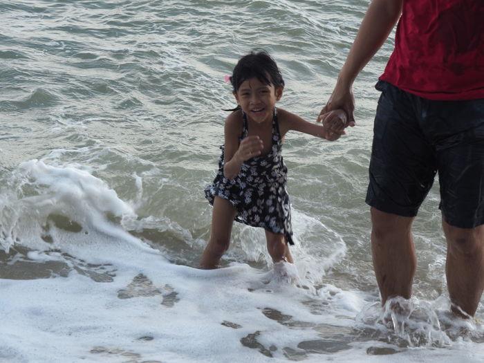 Full length of women on beach against sea