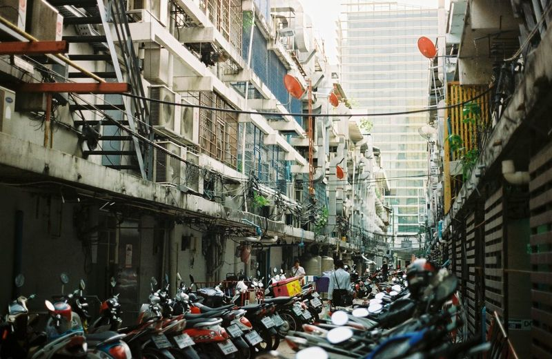Motorcycles Parked In Alley Amongst BUILDINGS IN CITY