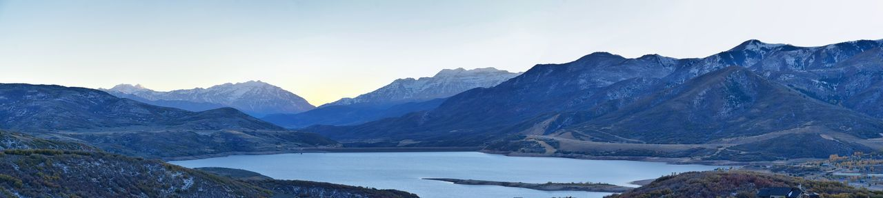 Scenic view of lake and mountains against sky during winter