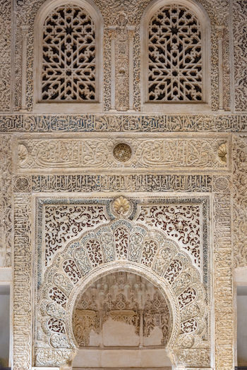 GRANADA, SPAIN - October 11, 2018: The famous Alhambra in Granada, Spain. It is a palace and fortress complex located in Granada. Granada SPAIN Alhambra Alhambra De Granada  Architecture Arabic Style Ancient Architecture Mosque Architecture Interior Design Built Structure Arch Building Exterior Pattern Travel Destinations Design Building Religion Place Of Worship Low Angle View Full Frame Spirituality Ceiling Floral Pattern Mural Architecture And Art