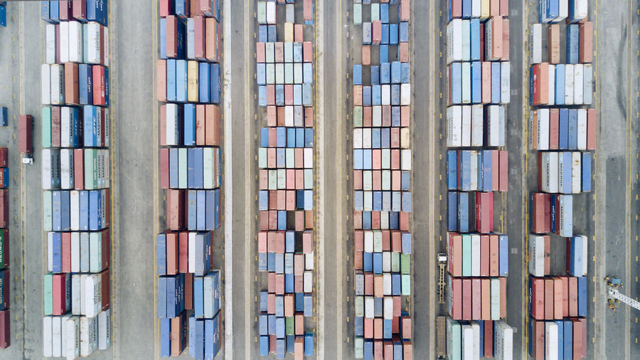 Directly above shot of stacked containers at harbor