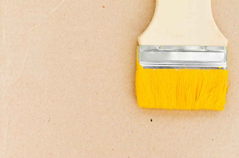 paint brush use for paint old wood background for equipment stock photography. House Artistic Construction Creativity Improvement Backgrounds Colorful Concept Construction Work Design Design Element Diminishing Perspective Education Object Paintbrush Space Tools Wall - Building Feature Wallpaper Yellow