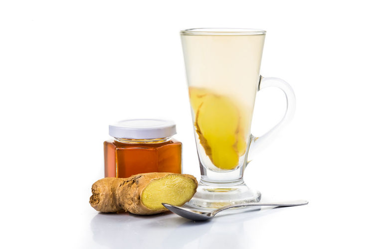 Refreshing and healthy ginger with raw organic honey drinks Ginger Tea Tea Copy Space Drink Drinking Glass Food Food And Drink Freshness Ginger Healthy Eating Honey Indoors  No People Refreshing Refreshment Still Life Studio Shot Wellbeing White Background