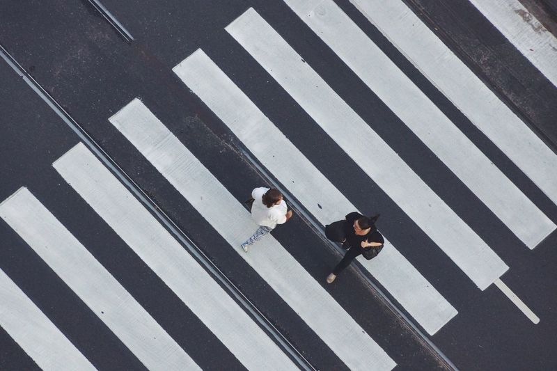 High Angle View Of Women Crossing Road