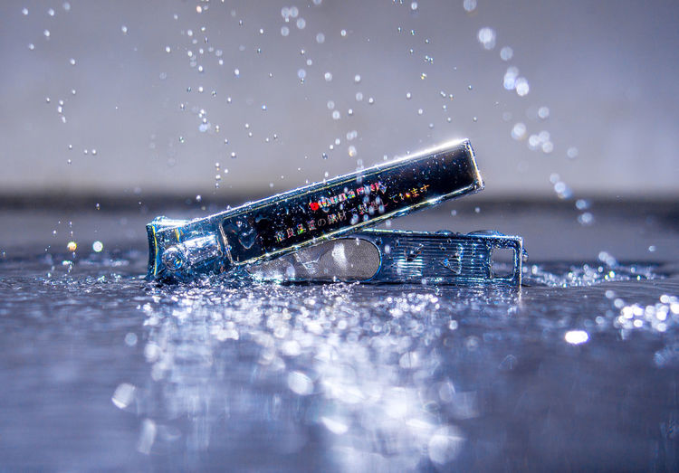 Close-up of water splashing on table
