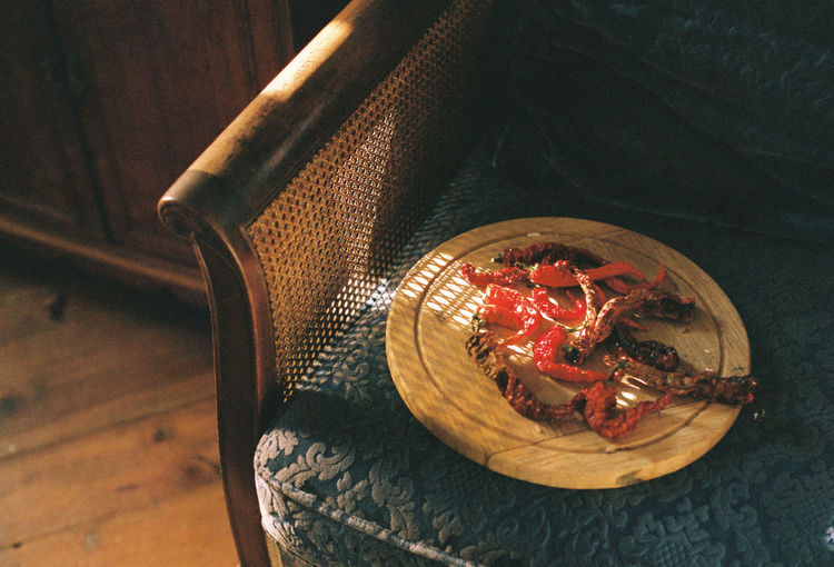 High angle view of dry red chili peppers on table