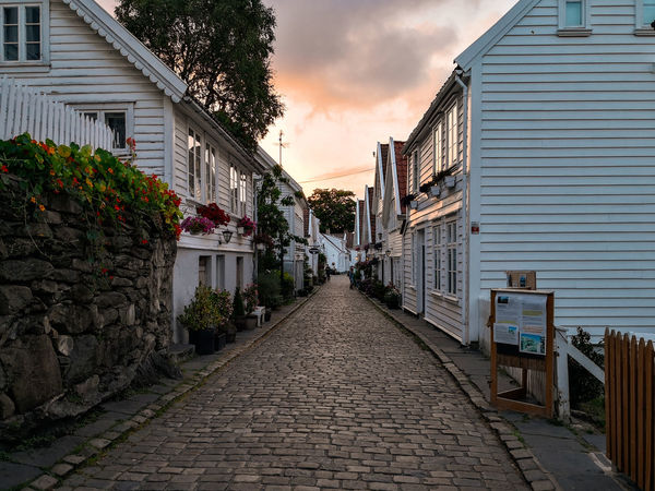 Stavanger old Town Norway🇳🇴 Old Town Stavanger Huaweiphotography Huawei Mate10pro Sky Architecture Built Structure Building Exterior Cloud - Sky Narrow Fence Gate Lane Long Alley Walkway Destinations Path Aged The Way Forward Pathway Residential Structure Empty Road Woods Chainlink