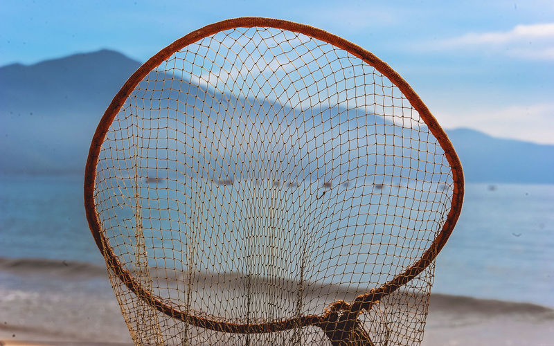 Close-up of fishing net on beach