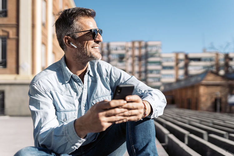 Young man using mobile phone