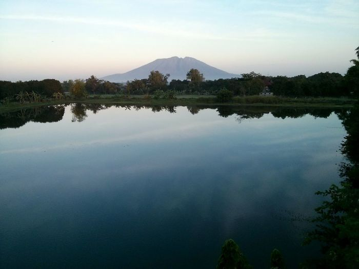 View of Mt. Arayat across a lake at dawn in Pampanga, Philippines. Reflection Tree Water Lake Mountain Sky Outdoors No People Reflecting Pool Landscape Nature Beauty In Nature Dawn Mt Arayat Arayat Volcano Pampanga Philippines Dim Light Tropical ASIA Asian  Travel EyeEmNewHere