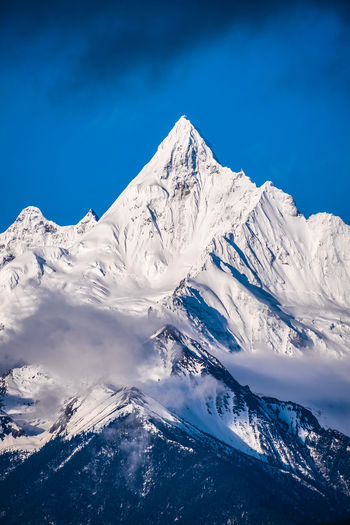 Cold Temperature Snow Mountain Sky Winter Beauty In Nature Scenics - Nature Snowcapped Mountain Mountain Range Blue Tranquil Scene Tranquility No People Nature Mountain Peak Day Environment Non-urban Scene White Color Formation Mountain Ridge Meili DeQin Yunnan China Tibet Top High Fog Cool Cold