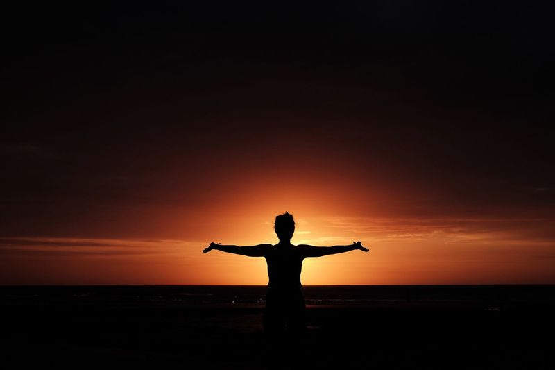 Embrace the Sun Silhouette Sunset Sea Arms Outstretched Water One Person Sky Standing Horizon Over Water Lifestyles Beach Healthy Lifestyle Tranquil Scene Nature Men Beauty In Nature Real People Outdoors People Adult Orange Color