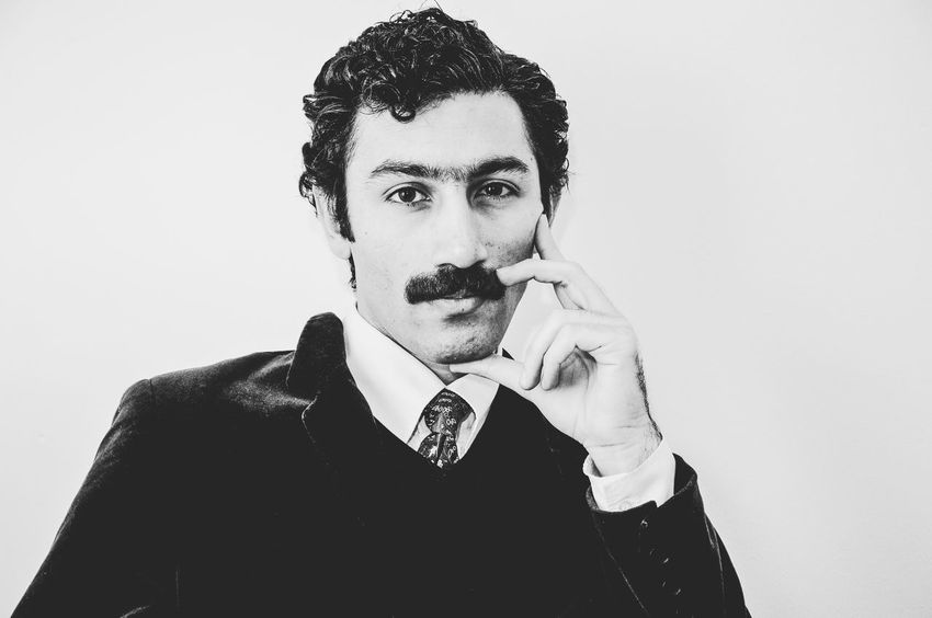 Man Movember Retro Suit Well Dressed Black And White Portrait Blackandwhite Day Hairstyle Lifestyles Looking At Camera Mustache One Person People Portrait Retro Styled Studio Shot Vintage White Background Young Adult