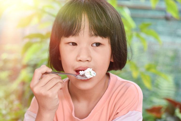 Portrait of cute boy eating food