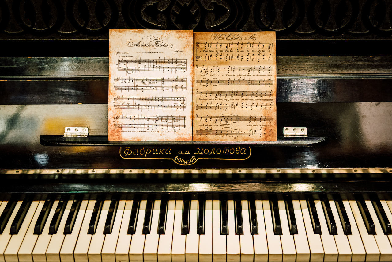 music, musical instrument, piano, piano key, arts culture and entertainment, sheet music, musical note, old-fashioned, antique, classical music, indoors, close-up, no people, day
