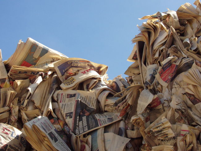 Daily news Clear Sky Low Angle View Mountains Of Newspaper News Newspaper Newspaper Variation No People Paper