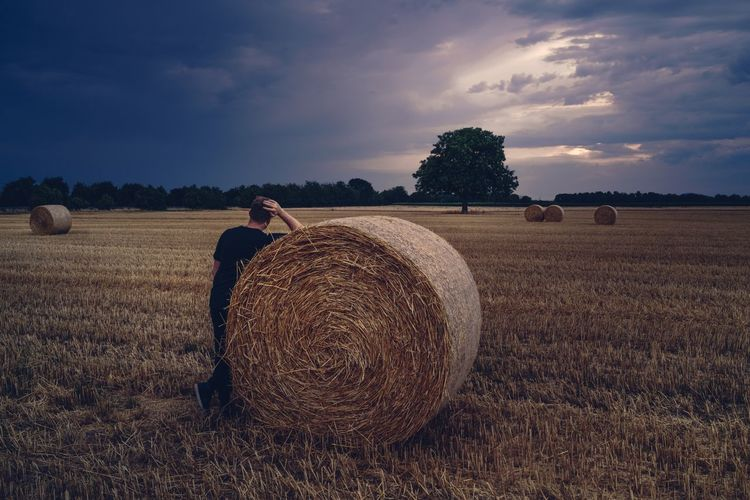 Field Bale  Agriculture Hay Sky Rural Scene Farm Cloud - Sky Landscape Tranquility Solitude One Person Tranquil Scene Hay Bale Nature Real People Beauty In Nature Scenics Outdoors Men