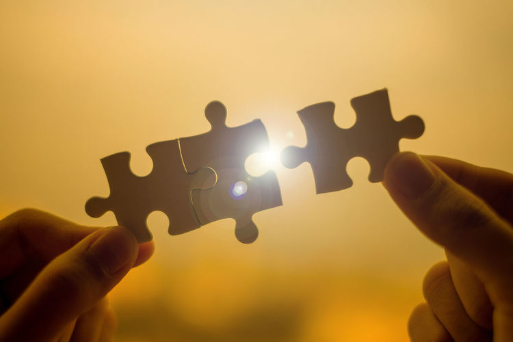 Cropped Hand Holding Jigsaw Pieces