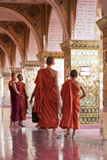 Children Adult Adults Only Architecture Buddist Monk Burma Children Monks Day Full Length Indoors  Maynmar Men Monks In Temple Monks Walk Orange Color People Place Of Worship Rear View Religion Spirituality Walking