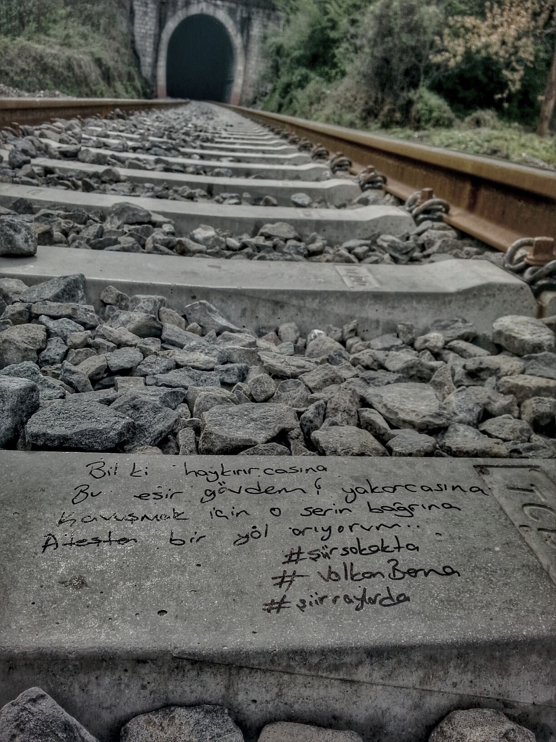 close-up, day, the way forward, no people, outdoors, diminishing perspective, high angle view, asphalt, sunlight, steps, transportation, road, pattern, road marking, textured, stone - object, nature, railroad track, stone material, surface level