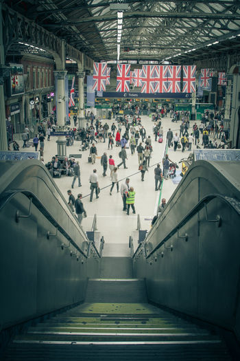 Crowd Union Jack Flag Union Jack Flags Steps Train Station Staircase Steps And Staircases Travel Railing Public Transportation Mode Of Transportation Communication Railroad Station High Angle View Architecture Transportation Large Group Of People Built Structure Indoors