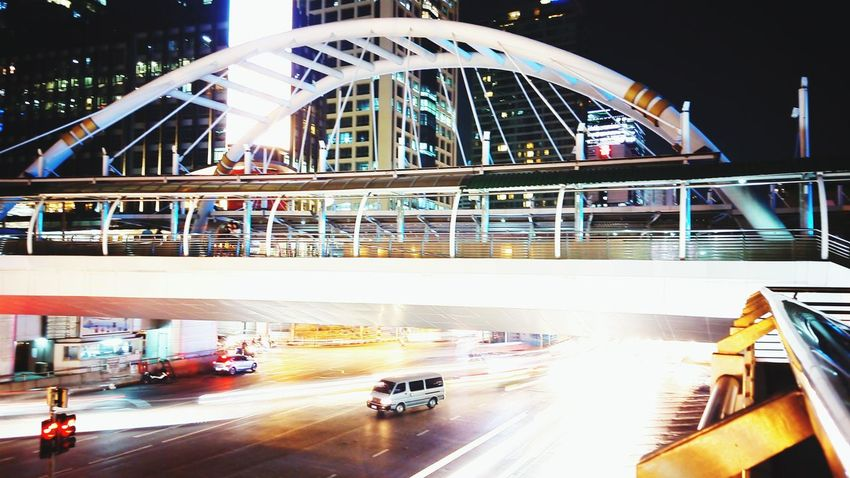 Lights City Bridge - Man Made Structure City Street Night Connection Cityscape Outdoors Architecture Transportation Traffic Built Structure Business Finance And Industry Illuminated Travel Destinations Building Exterior Modern Rush Hour Skyscraper People First Eyeem Photo