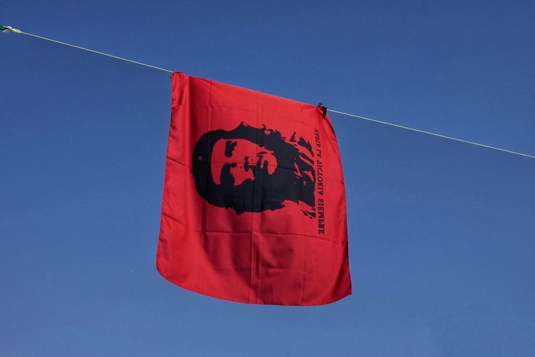 Low angle view of flag on rope against clear blue sky