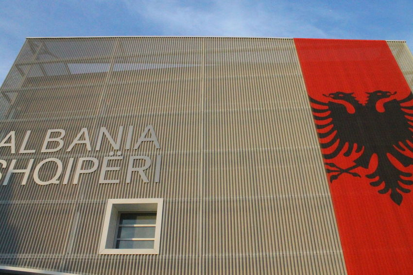 Albania Architecture Building Exterior Communication Day Flag Flags Low Angle View No People Outdoors Patriotism Shqiperia Sky Text