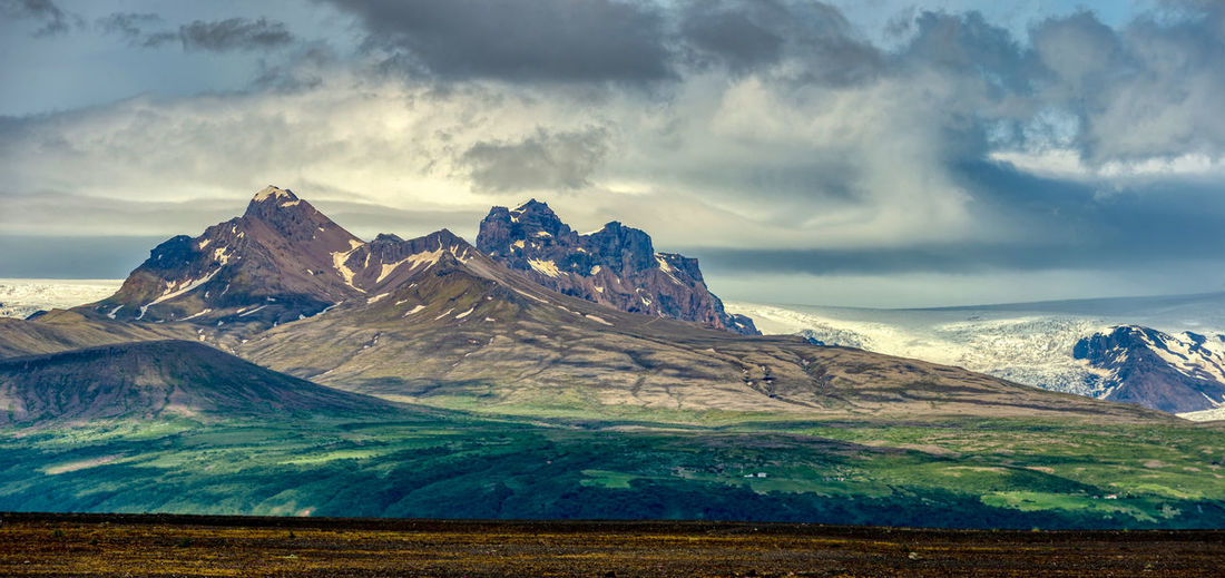 Panoramic view rocky mountains and gracias in the countryside of southern iceland.