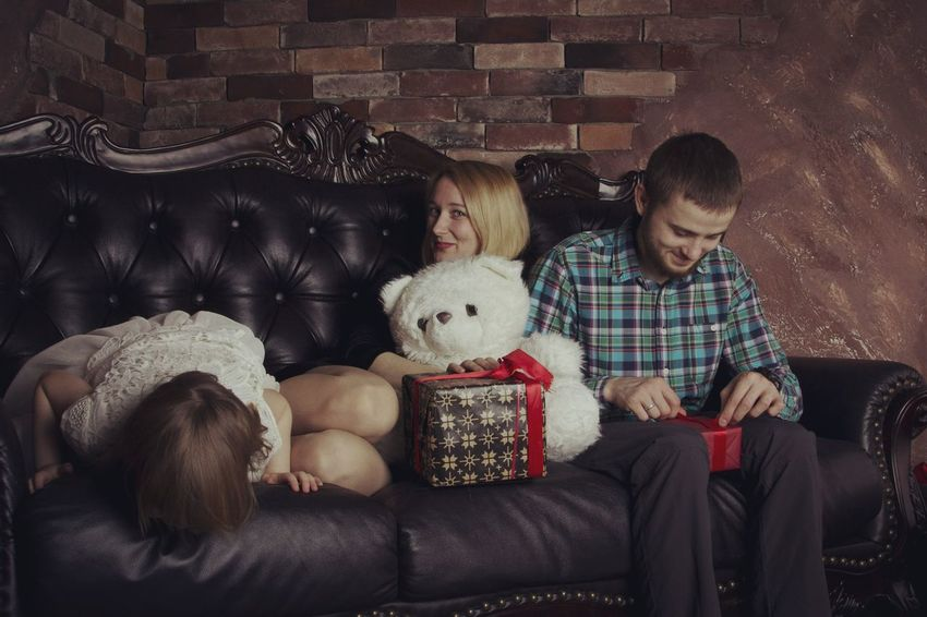 Family Togetherness Sitting Men Bonding Happiness Domestic Life Males  Living Room Females Father Movie Theater Christmas Present christmas tree