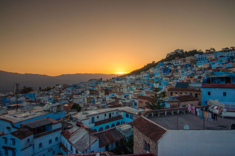 The blue town Africa Architecture Blue Building Exterior Chefchaouen City Cityscape Igniting Morocco Mountain No People Outdoors Roof Sky Sunset Town Travel Travel Destinations Traveling Urban Skyline