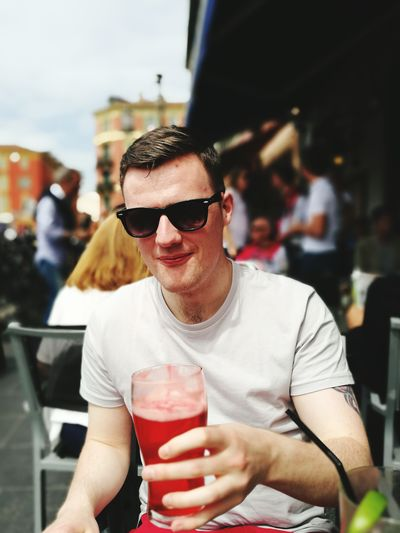 The Portraitist - 2017 EyeEm Awards Sunglasses One Man Only Individuality Adult Food And Drink Confidence  Portrait Smiling Looking At Camera People Sitting Cocktail Drinking Glass Drink Lifestyles