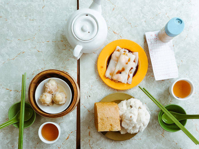 "We call it as ""Yum Cha"" in Hong Kong Bowl Bread Breakfast Close-up Coffee - Drink Day Directly Above Drink Food Food And Drink Freshness Healthy Eating High Angle View Indoors  No People Plate Ready-to-eat Table Tea - Hot Drink Teapot"