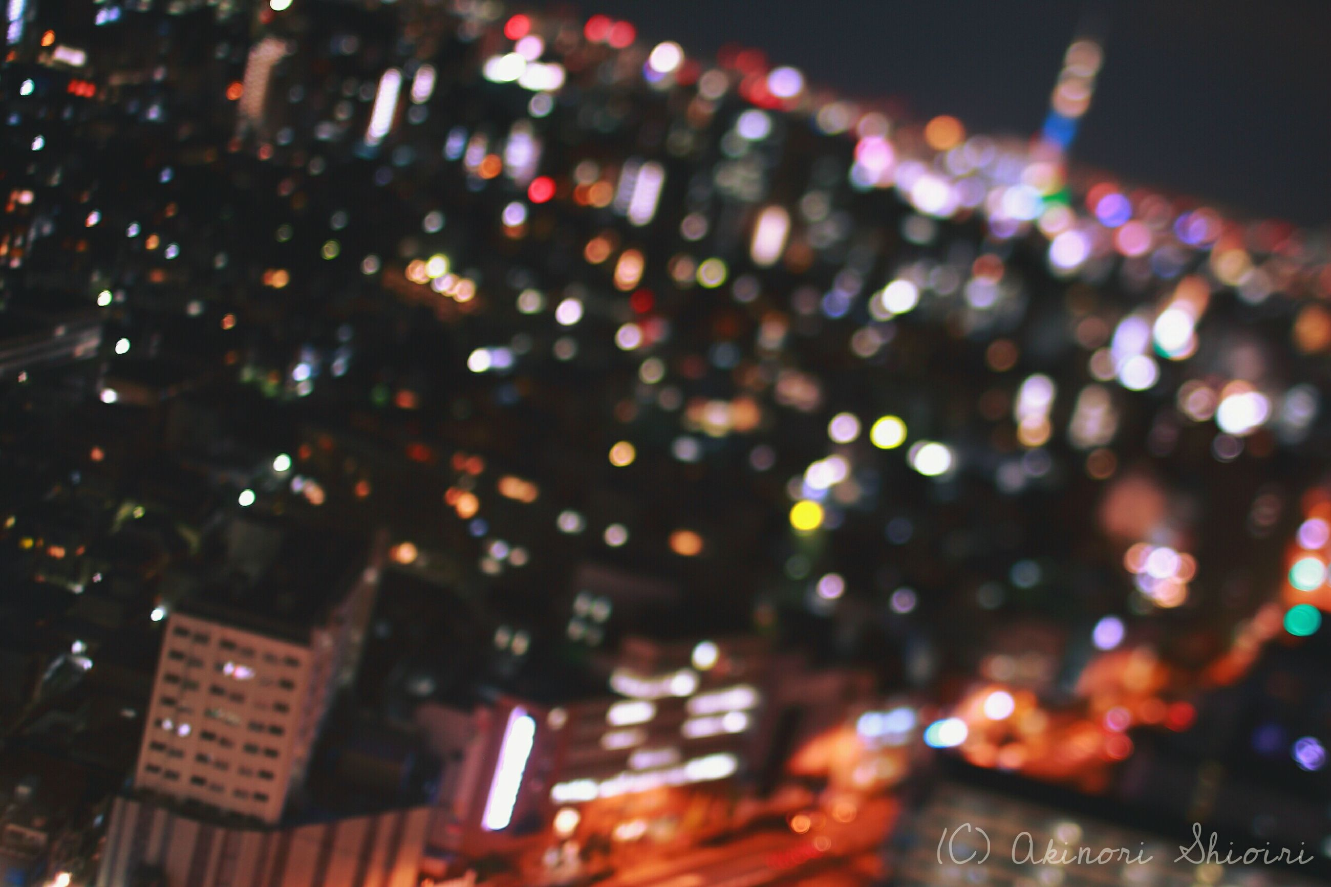 illuminated, night, defocused, lighting equipment, city, light - natural phenomenon, building exterior, glowing, architecture, multi colored, built structure, light, indoors, no people, selective focus, high angle view, dark, city life, celebration