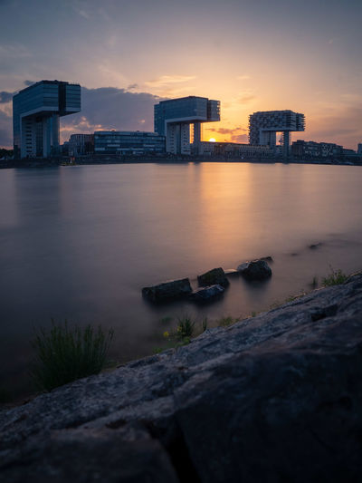Kranhäuser Architecture Building Building Exterior Built Structure City Cityscape Cloud - Sky Nature No People Office Building Exterior Orange Color Outdoors River Rock Rock - Object Sky Skyscraper Solid Sunset Water