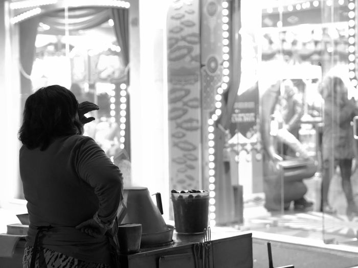 Rear View One Person Real People Standing Leisure Activity Adult Lifestyles Women Waist Up Casual Clothing Window Indoors  Focus On Foreground Day Looking Incidental People Glass - Material Three Quarter Length Hairstyle Tired Working Work Hard Castanhas Vida Da Noite