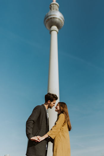 Two People Sky Togetherness Bonding Men Couple - Relationship Architecture Low Angle View Standing Adult Love Tower Blue Day Communication Women Young Adult People Emotion Outdoors Berlin Berlin Landmark TV Tower Thattoweragain Dancing Walking Exploring Urban Copy Space Real People