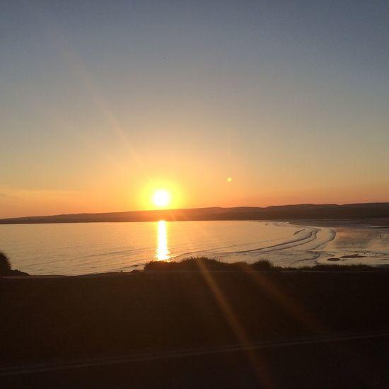 Sunset Sea Sun Scenics Nature Beauty In Nature Tranquility EyeEm Best Shots Water EyeEmNewHere EyeEm Orange Color Tranquil Scene Sunlight Beach Sky Silhouette Reflection Idyllic No People Outdoors Horizon Over Water