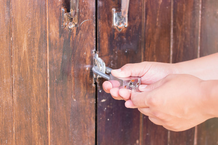 Cropped hands opening lock
