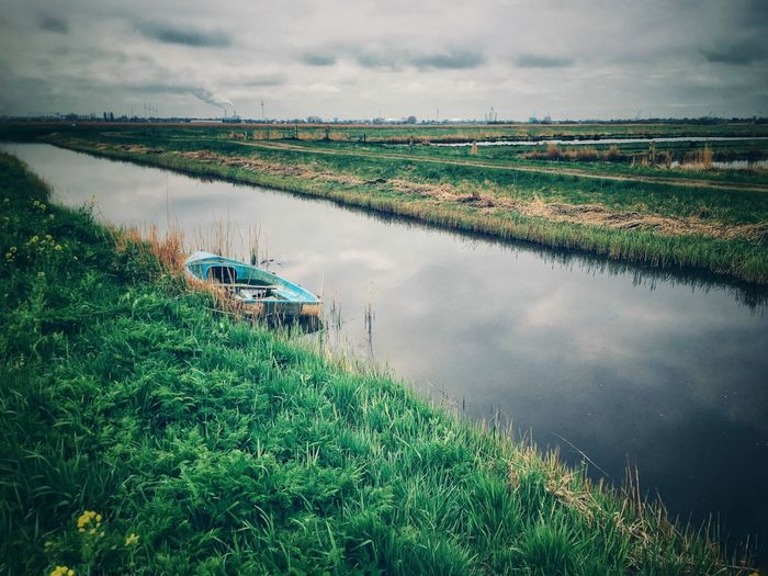 Canals Boat EyeEm Nature Lover EyeEm Best Shots EyeEmNewHere Canals And Waterways Canal Plant Water Beauty In Nature Landscape Scenics - Nature Sky Green Color Cloud - Sky Rural Scene Land Nature Tranquil Scene No People