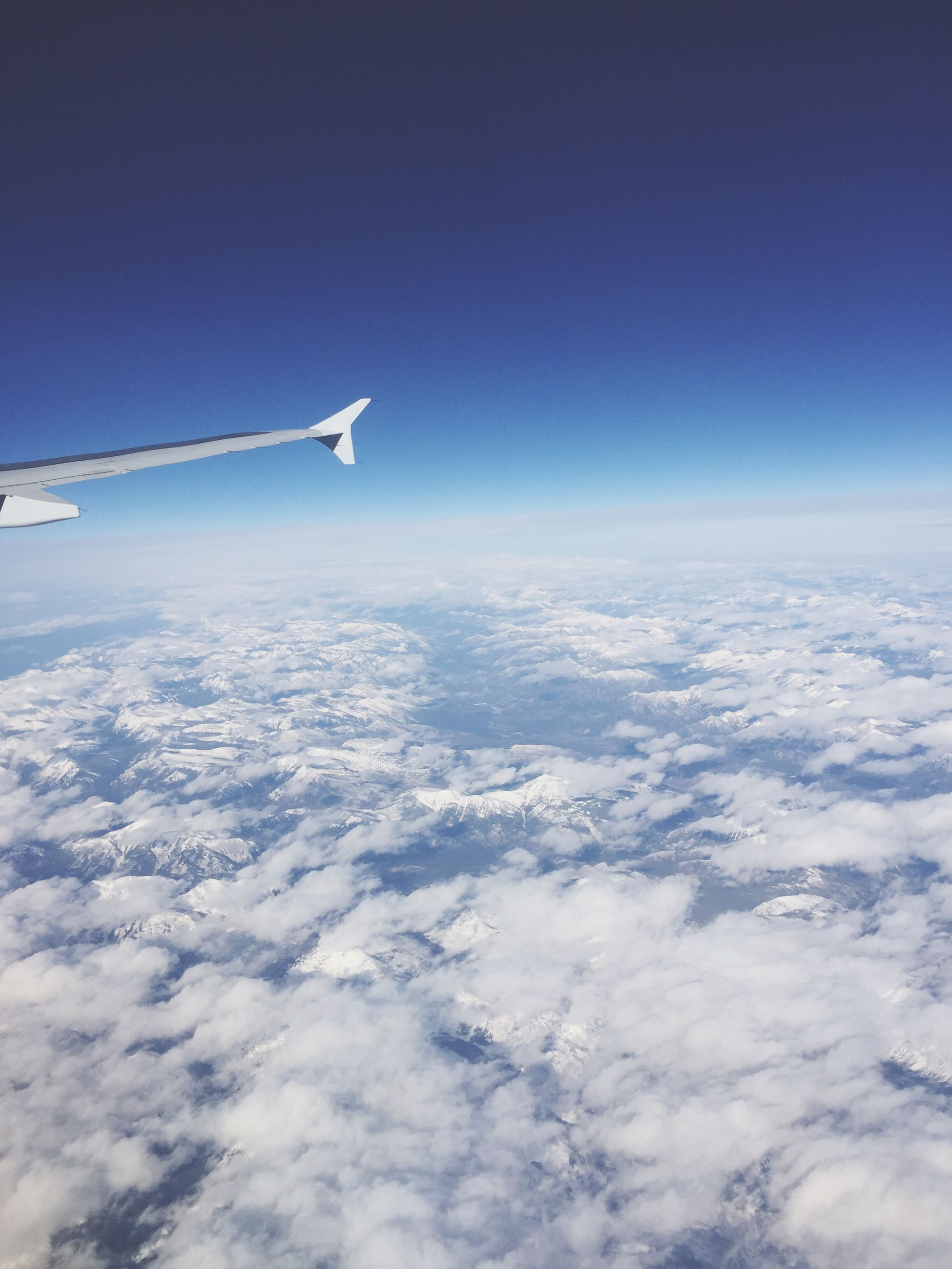 aerial view, flying, airplane, blue, nature, travel, beauty in nature, cloud - sky, scenics, journey, sky, no people, snow, cold temperature, cloudscape, winter, outdoors, day, landscape, airplane wing