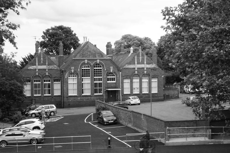 Architecture Black & White Black And White Blackandwhite Brick Wall Built Structure Carpark Cars Cloud Cloud - Sky Clouds And Sky Day Growth Lines Outdoors Parked Railing Tree Trees Trees And Sky Victorian Victorian Architecture Pivotal Ideas Windows Can You See The Ghost Cyclist?