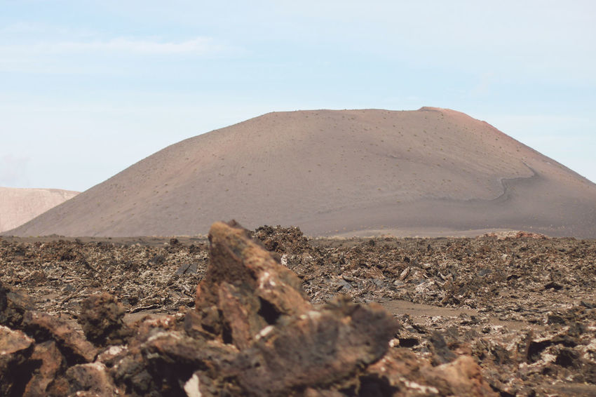 Canary Islands Lanzarote SPAIN Travel Volcanoes Arid Climate Beauty In Nature Climate Cloud - Sky Day Desert Environment Geological Formation Island Land Landscape Mountain Nature No People Non-urban Scene Outdoors Remote Scenics - Nature Sky Solid Tranquil Scene Tranquility Volcanic  Volcano