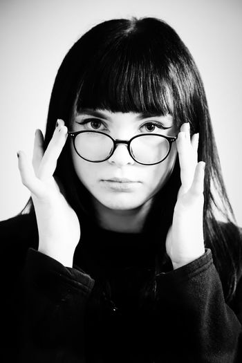Blackandwhite Black And White Black & White Black And White Portrait Portrait Of A Woman Portraits Portrait Headshot Eyeglasses  Glasses Front View One Person Looking At Camera Real People Indoors  Close-up Lifestyles Leisure Activity Young Adult Hairstyle Young Women Women Studio Shot Casual Clothing Bangs Beautiful Woman Human Face