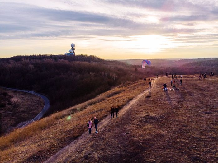 Leisure activities on the Drachenberg in Berlin Drone  Teufelsberg Real People Sunset Sky Nature Sunlight Large Group Of People Walking Leisure Activity Landscape Lifestyles Outdoors Cloud - Sky Beauty In Nature Scenics Mountain Day People Go Higher