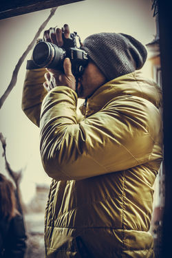 Adult Camera - Photographic Equipment Close-up Day Digital Camera Holding Leisure Activity Lifestyles Men One Person Outdoors People Photographer Photographing Photography Themes Real People Standing Technology Young Adult