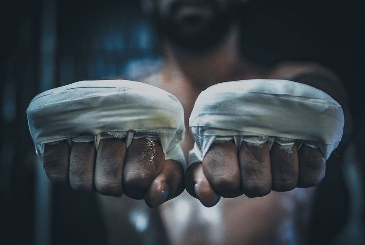 Close-up of boxer hands with bandages